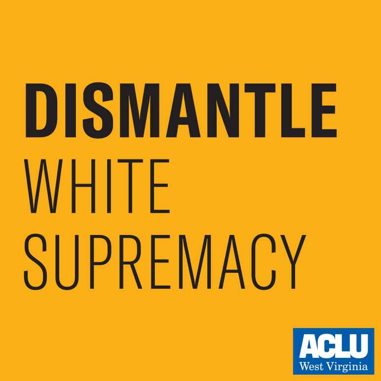 "Black text on a gold background says ""Dismantle White Supremacy."""