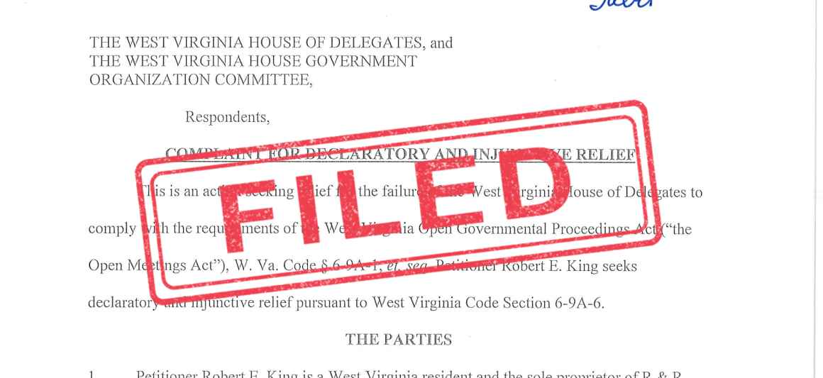 """""""Filed"""" stamped in red over an image of a lawsuit"""