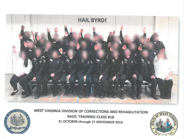 Photo shows a class of WV Corrections cadets, arms raised in a Nazi salute. Faces are blurred.