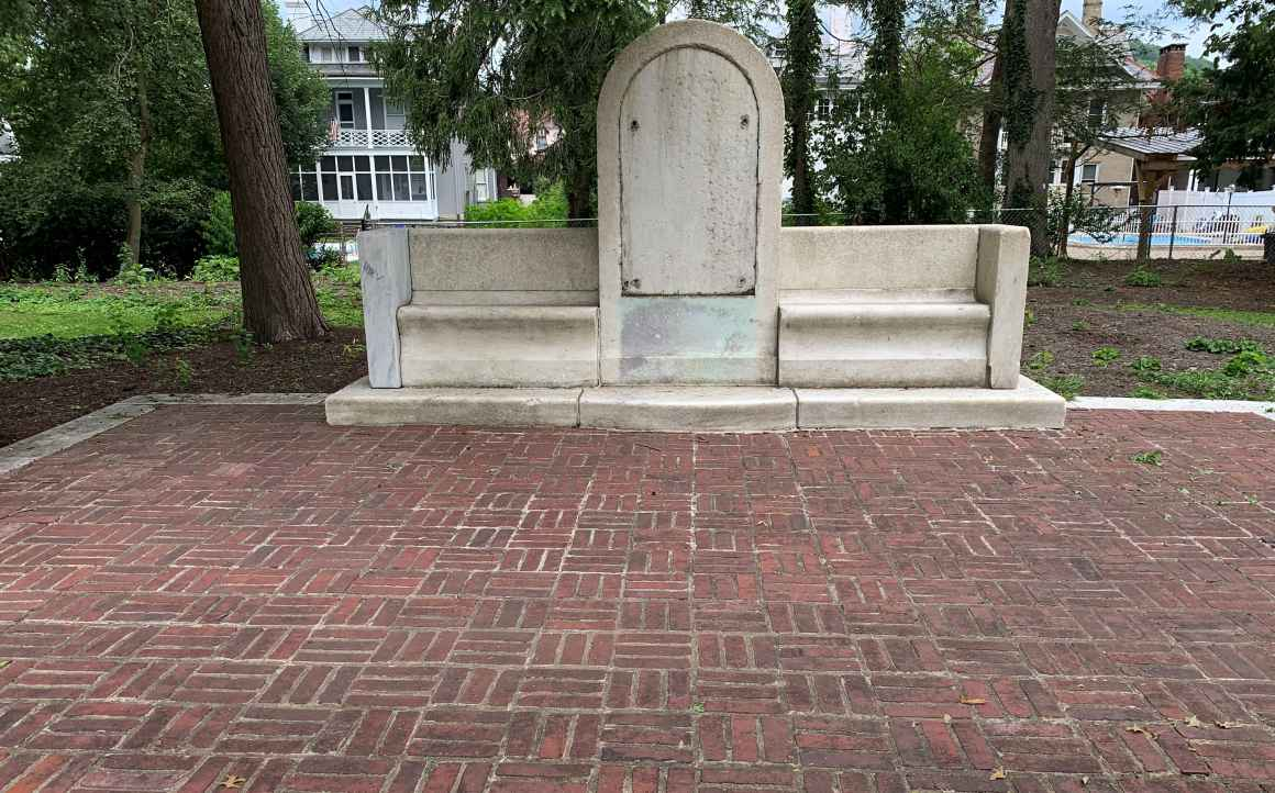 A blank monument is shown after a confederate plaque was removed from its face