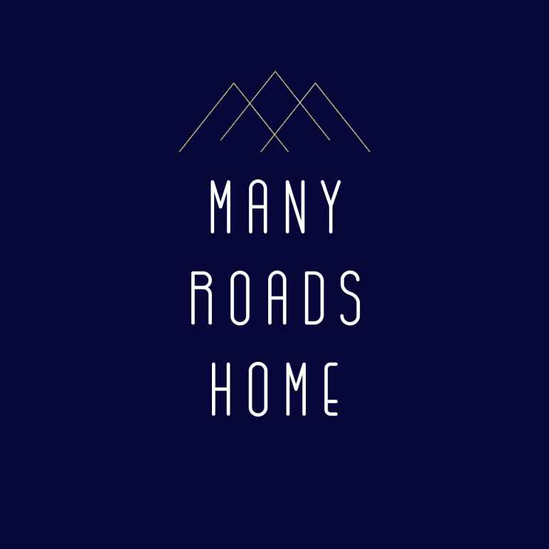 "Image features a mountain scape with the words ""Many Roads Home"""